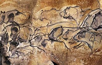 STONE AGE CAVE PAINTING BY TORCHLIGHT
