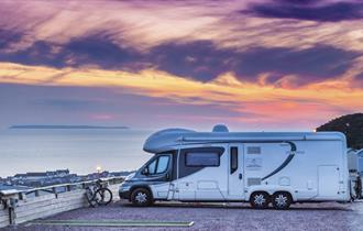 caravan at sunset